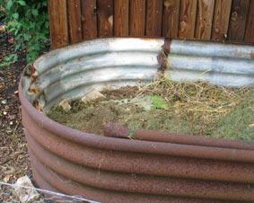 compost bin made from Nissen hut