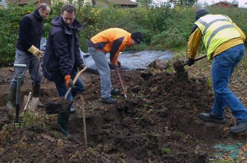 digging a trench for hugelkultur