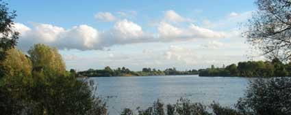 clouds across a reservoir in June