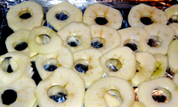 Drying apples at home - uncooked apple rings ready to go in the oven