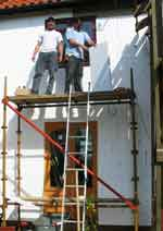 builders applying external wall insulation