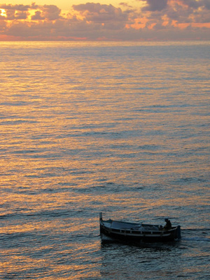 small fishing boat at sunset