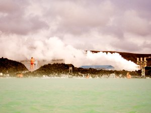 geothermal heating plant in Iceland with swimming pool in foreground