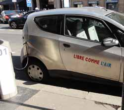 Libre comme l'air electric car charging up in a Paris street