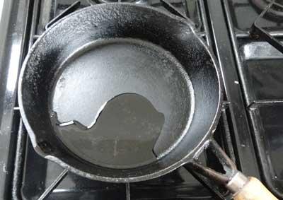 pancake cooking - pour a little oil